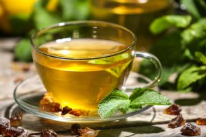 a cup of mint tea on a table
